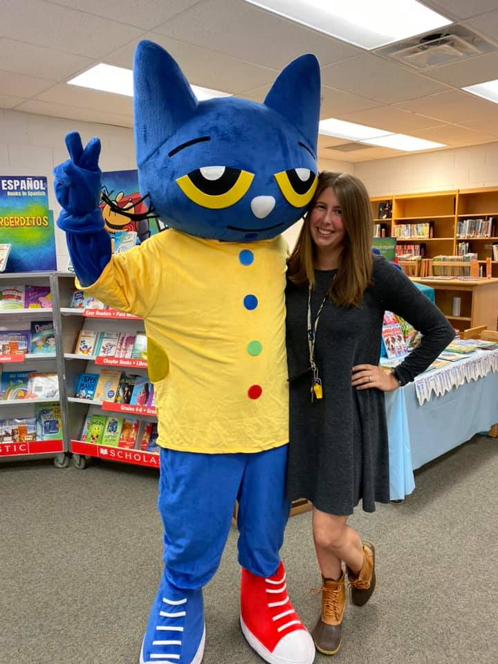 Mrs. Giba standing with Pete the Cat